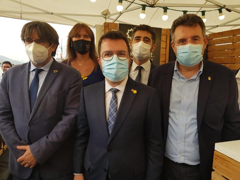 Foto : Miquel Noguer visita l'estand de Girona Excel·lent a l'Adifolk, a l'Alguer, acompanyat de Pere Aragonès i Carles Puig